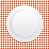 White plate on red tablecloth Stock Photography