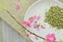 White plate with rice tea and peach flower blooming, detail. White plate with rice tea and peach flower blooming royalty free stock images