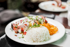 White plate with rice and vegetables serving Royalty Free Stock Image