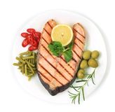 White plate of salmon steak with vegetables. Royalty Free Stock Photo