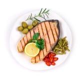 White plate of salmon steak Royalty Free Stock Photo