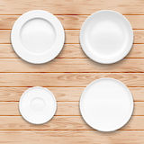 White plate set on wooden background. Kitchen Royalty Free Stock Photography
