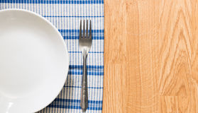 White plate and silver fork Stock Photo