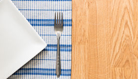 White plate and silver fork Stock Photos