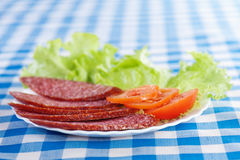 White plate (sliced ��salami Stock Photography