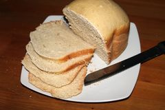 Plate with slices of bread on a table stock photos