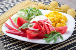 White plate with slices of fresh vegetables Stock Photos