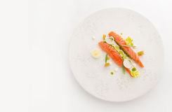 White plate with slices salmon snack. Smoked salmon slices on white plate top view Royalty Free Stock Photos
