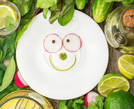 White plate with a smile of spring ingredients Stock Image