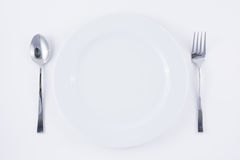White plate , spoon and fork Royalty Free Stock Photography