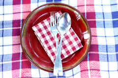 White plate spoon and fork Royalty Free Stock Photos