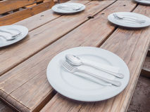 White plate with spoon and fork Royalty Free Stock Photos