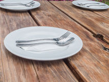 White plate with spoon and fork Stock Photos