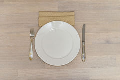 White plate with spoon and knife Stock Photography