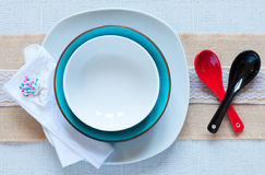 White plate and spoons Stock Images