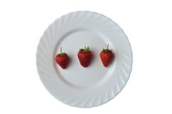 White plate with strawberries Stock Image