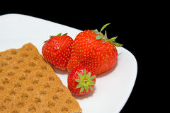 White plate with strawberry and cracker Royalty Free Stock Photos