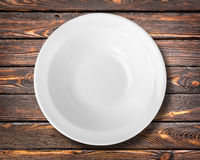 White plate on a table Royalty Free Stock Photography