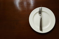 White plate on the table Royalty Free Stock Image