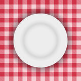 White plate on a table cloth Royalty Free Stock Image