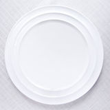 White plate on tablecloth Royalty Free Stock Photo
