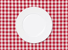 White plate on tablecloth Royalty Free Stock Photography