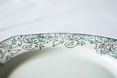 White plate on the tablecloth Stock Images