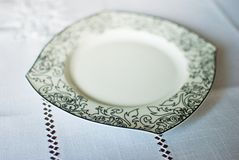 White plate on the tablecloth Royalty Free Stock Image