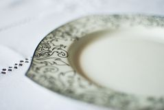 White plate on the tablecloth Stock Photography