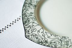 White plate on the tablecloth Royalty Free Stock Images