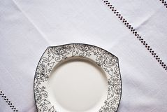 White plate on the tablecloth Stock Photo