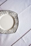 White plate on the tablecloth Royalty Free Stock Photo