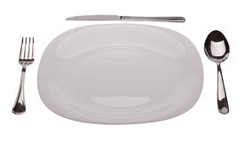 White plate with tablewares. Plate with tablewares on white background Royalty Free Stock Photo
