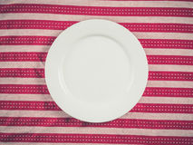 White plate on tea towel Royalty Free Stock Photo