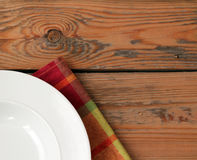 White plate with tissued napkin Royalty Free Stock Photography