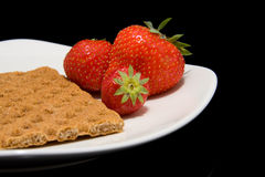 White plate with trawberry and cracker Royalty Free Stock Image