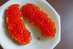 Two sandwiches with salmon caviar. Royalty Free Stock Photography