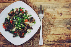 White plate with vegetables and roasted mushrooms Royalty Free Stock Images