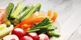 White plate with vegetables for a vegetarian salad Stock Photography