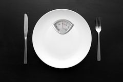 White plate with weight scale Royalty Free Stock Images