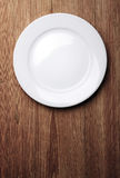 White plate on wood table Stock Photo