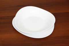 White plate on the wooden table Stock Photo