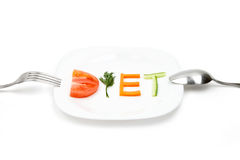 White plate with word diet composed of slices of different fruits and vegetables Royalty Free Stock Photography