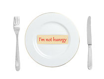 White plate with words I`m not hungry on white Stock Image
