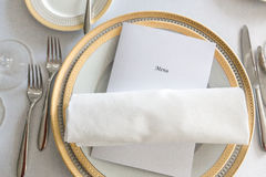 White plate yellow canvas tablecloth napkin serviette Royalty Free Stock Images