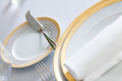 White plate yellow canvas tablecloth napkin serviette Stock Image