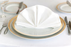 White plate yellow canvas tablecloth napkin serviette. Fork Royalty Free Stock Photography