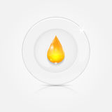 White plate and yellow drop Stock Photos