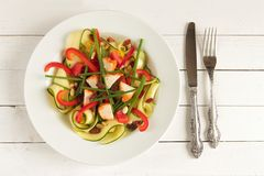 White plate with zucchini salad Royalty Free Stock Photos