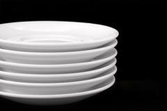 White plates. Isolated on black background Stock Image